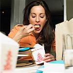 Woman Eating Chinese Food At Work    Stock Photo - Premium Rights-Managed, Artist: Marnie Burkhart, Code: 700-00593076