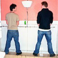 Boys urinating Stock Photo - Premium Royalty-Freenull, Code: 614-00597881