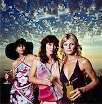Three Woman At A Cocktail Party    Stock Photo - Premium Rights-Managed, Artist: Masterfile, Code: 700-00606401