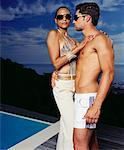 Couple Embracing By Side of the Pool Stock Photo - Premium Rights-Managed, Artist: Masterfile, Code: 700-00606421