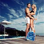 Pool Boy Embracing Woman in Bikini Stock Photo - Premium Rights-Managed, Artist: Masterfile, Code: 700-00606431