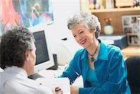 Mature Woman and Man In Office    Stock Photo - Premium Rights-Managednull, Code: 700-00607054
