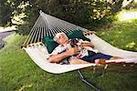Mature Man Napping in Hammock With Dog    Stock Photo - Premium Rights-Managed, Artist: Steve Prezant, Code: 700-00607061