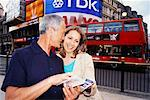 Couple Looking at Guide Book in Piccadilly Circus, London, England    Stock Photo - Premium Rights-Managed, Artist: Mark Leibowitz, Code: 700-00607156