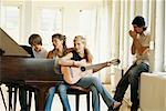 Friends Playing Music    Stock Photo - Premium Rights-Managed, Artist: Michael Goldman, Code: 700-00607718