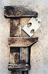Pipe Wrench Gripping Puzzle Piece    Stock Photo - Premium Rights-Managed, Artist: David Muir, Code: 700-00608327