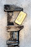 Wrench Gripping Gold Bar    Stock Photo - Premium Rights-Managed, Artist: David Muir, Code: 700-00608333