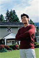 Man Standing in Front of House    Stock Photo - Premium Rights-Managednull, Code: 700-00608650