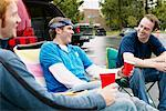Men at Tailgate Party    Stock Photo - Premium Rights-Managed, Artist: Peter Griffith, Code: 700-00608835
