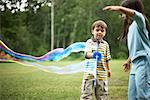 Children Blowing Bubbles    Stock Photo - Premium Rights-Managed, Artist: Jerzyworks, Code: 700-00609024