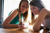 Teenagers with Cell Phones    Stock Photo - Premium Rights-Managednull, Code: 700-00609534