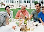 Family Eating Dinner Outside    Stock Photo - Premium Rights-Managed, Artist: Masterfile, Code: 700-00610198