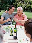 Father and Adult Son Drinking Wine at Outdoor Family Dinner    Stock Photo - Premium Rights-Managed, Artist: Masterfile, Code: 700-00610199