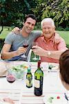 Father and Adult Son Drinking Wine at Outdoor Family Dinner    Stock Photo - Premium Rights-Managed, Artist: Masterfile, Code: 700-00610200