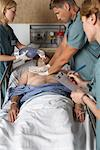 Doctors Trying to Resuscitate Patient    Stock Photo - Premium Rights-Managed, Artist: Graham French, Code: 700-00610977