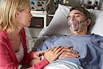 Wife Visiting Husband in Hospital    Stock Photo - Premium Rights-Managed, Artist: Graham French, Code: 700-00610978