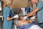 Doctors Trying to Resuscitate Patient    Stock Photo - Premium Rights-Managed, Artist: Graham French, Code: 700-00610983