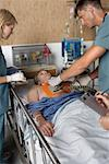Doctors Trying to Resuscitate Patient    Stock Photo - Premium Rights-Managed, Artist: Graham French, Code: 700-00610984