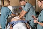Doctors Trying to Resuscitate Patient    Stock Photo - Premium Rights-Managed, Artist: Graham French, Code: 700-00610985