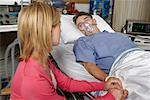 Woman Visiting Man in Hospital    Stock Photo - Premium Rights-Managed, Artist: Graham French, Code: 700-00610986