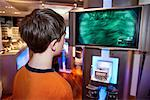 Teen Playing Video Game    Stock Photo - Premium Rights-Managed, Artist: Michael Mahovlich, Code: 700-00611114