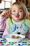 Girl Eating Breakfast    Stock Photo - Premium Rights-Managed, Artist: Roy Ooms, Code: 700-00616890