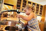Girl Washing Dishes    Stock Photo - Premium Rights-Managed, Artist: Roy Ooms, Code: 700-00616902
