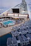 Cruise Ship Deck With Lounge Chairs, Swimming Pool, and Movie Screen    Stock Photo - Premium Rights-Managed, Artist: dk & dennie cody, Code: 700-00617415