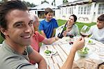 Family Eating Outdoors    Stock Photo - Premium Rights-Managed, Artist: Masterfile, Code: 700-00617632