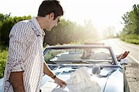 road trip - Man Looking at Map    Stock Photo - Premium Rights-Managednull, Code: 700-00618437