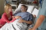 Wife Visiting Husband in Hospital    Stock Photo - Premium Rights-Managed, Artist: Graham French, Code: 700-00623293