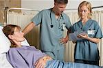 Doctors with Patient at Hospital