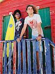Friends by Beach Hut with Surfboard    Stock Photo - Premium Rights-Managed, Artist: Masterfile, Code: 700-00623339
