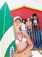 Young Woman Holding Surfboard On The Beach    Stock Photo - Premium Rights-Managednull, Code: 700-00623345