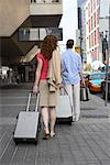 Couple Walking with Luggage    Stock Photo - Premium Rights-Managed, Artist: Michael Mahovlich, Code: 700-00635355