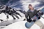 Man with Snowboard, Portillo, Andes Mountains, Chile    Stock Photo - Premium Rights-Managed, Artist: Peter Barrett, Code: 700-00635472