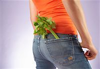 Woman With Celery in Her Jeans Pocket    Stock Photo - Premium Rights-Managednull, Code: 700-00635821