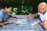 Father and Son Playing Checkers    Stock Photo - Premium Rights-Managed, Artist: Noel Hendrickson, Code: 700-00639366