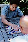 Son and Father Playing Checkers    Stock Photo - Premium Rights-Managed, Artist: Noel Hendrickson, Code: 700-00639367