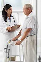Doctor with Patient    Stock Photo - Premium Rights-Managednull, Code: 700-00639398