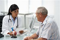 Doctor with Patient    Stock Photo - Premium Rights-Managednull, Code: 700-00639401