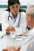 Doctor with Patient    Stock Photo - Premium Rights-Managednull, Code: 700-00639402