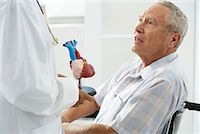 Doctor with Patient    Stock Photo - Premium Rights-Managednull, Code: 700-00639406