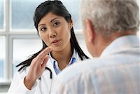 Doctor with Patient    Stock Photo - Premium Rights-Managednull, Code: 700-00639413