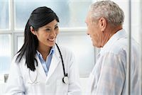 Doctor with Patient    Stock Photo - Premium Rights-Managednull, Code: 700-00639414