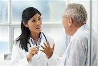 Doctor with Patient    Stock Photo - Premium Rights-Managednull, Code: 700-00639415