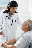 Doctor with Patient    Stock Photo - Premium Rights-Managednull, Code: 700-00639419