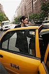 Business Woman Getting into Taxi    Stock Photo - Premium Rights-Managed, Artist: Mark Leibowitz, Code: 700-00639596