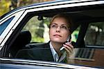 Businesswoman Using Cellular Phone in Car    Stock Photo - Premium Rights-Managed, Artist: Philip Rostron, Code: 700-00641747