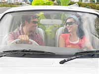 Couple in Car, Plants In Backseat    Stock Photo - Premium Rights-Managednull,